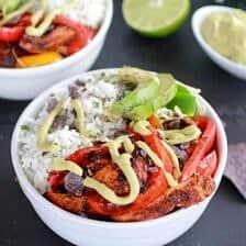 Fiesta Chicken + Cilantro Lime Rice Fajita Bowl with Avocado Chipotle Crema.