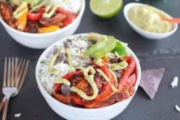 Fiesta Chicken + Cilantro Lime Rice Fajita Bowl with Avocado Chipotle Crema.