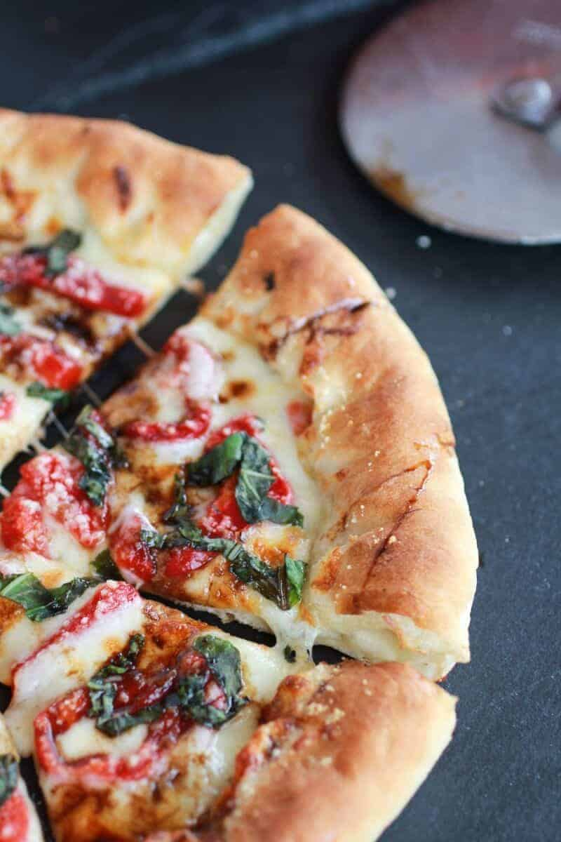 Green Olive Pesto Pizza with Feta Stuffed Crust, Roasted Red Peppers and Balsamic Drizzle