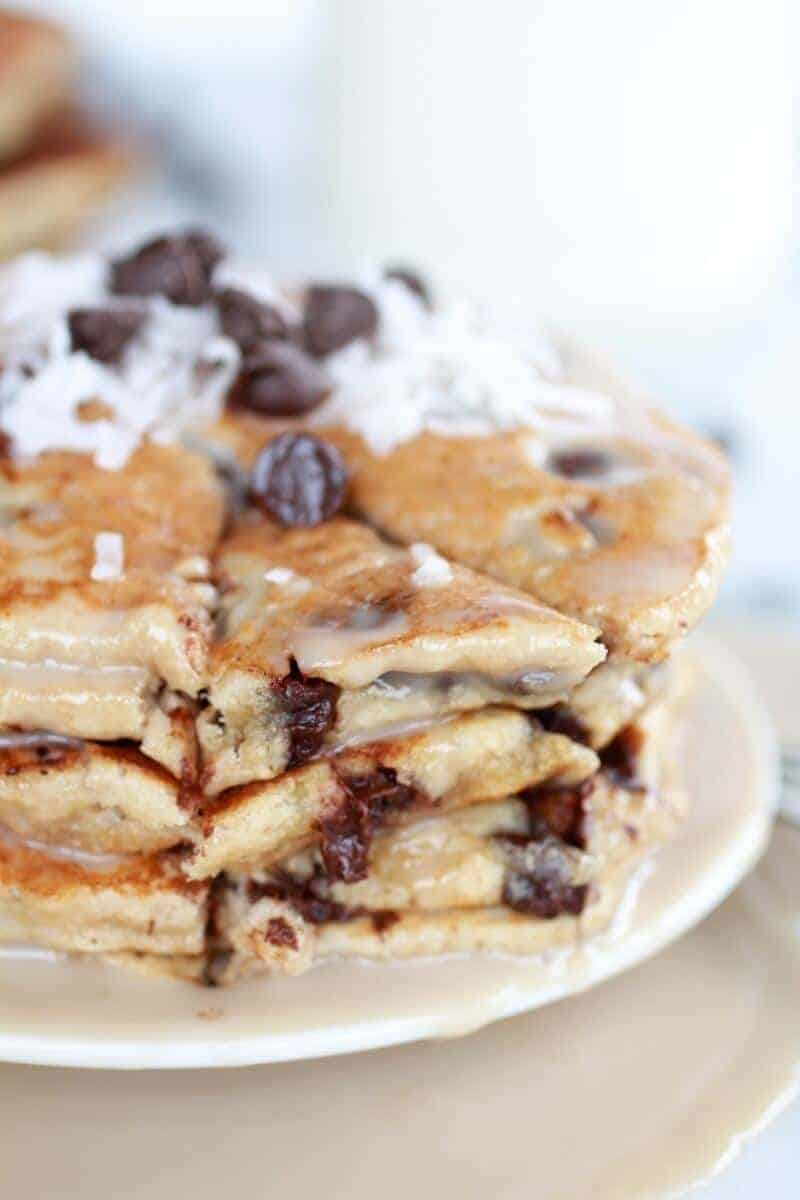 Whole Wheat Chocolate Chip Banana Bread Pancakes with a Vanilla Coconut Glaze