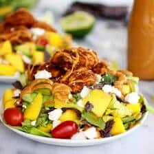 Tortilla Chip Crusted Chicken Salad with Avocado Chipotle Lime Dressing and Queso Fresco
