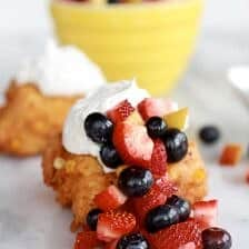 Corn Fritters with Coconut Whipped Cream and Sweet Honey Bourbon Syrup.