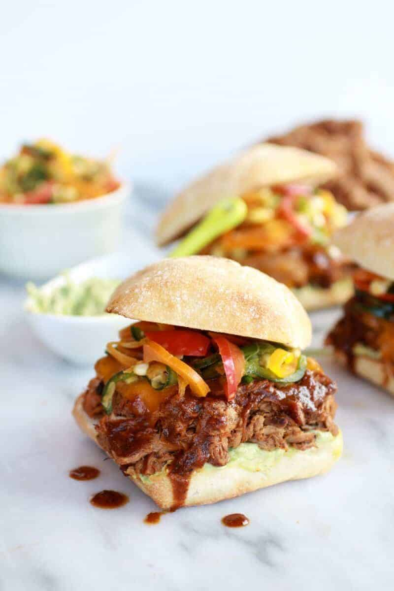 Cheesy Crockpot Cajun Pulled Pork with Southwest Pepper-Corn Slaw | halfbakedharvest.com