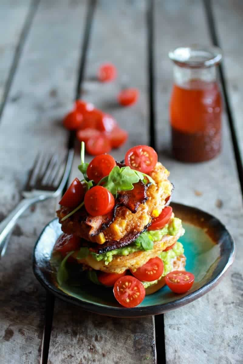Avocado and Gouda BLT Corn Fritter Stacks with Chipotle Bourbon Dressing | halfbakedharvest.com