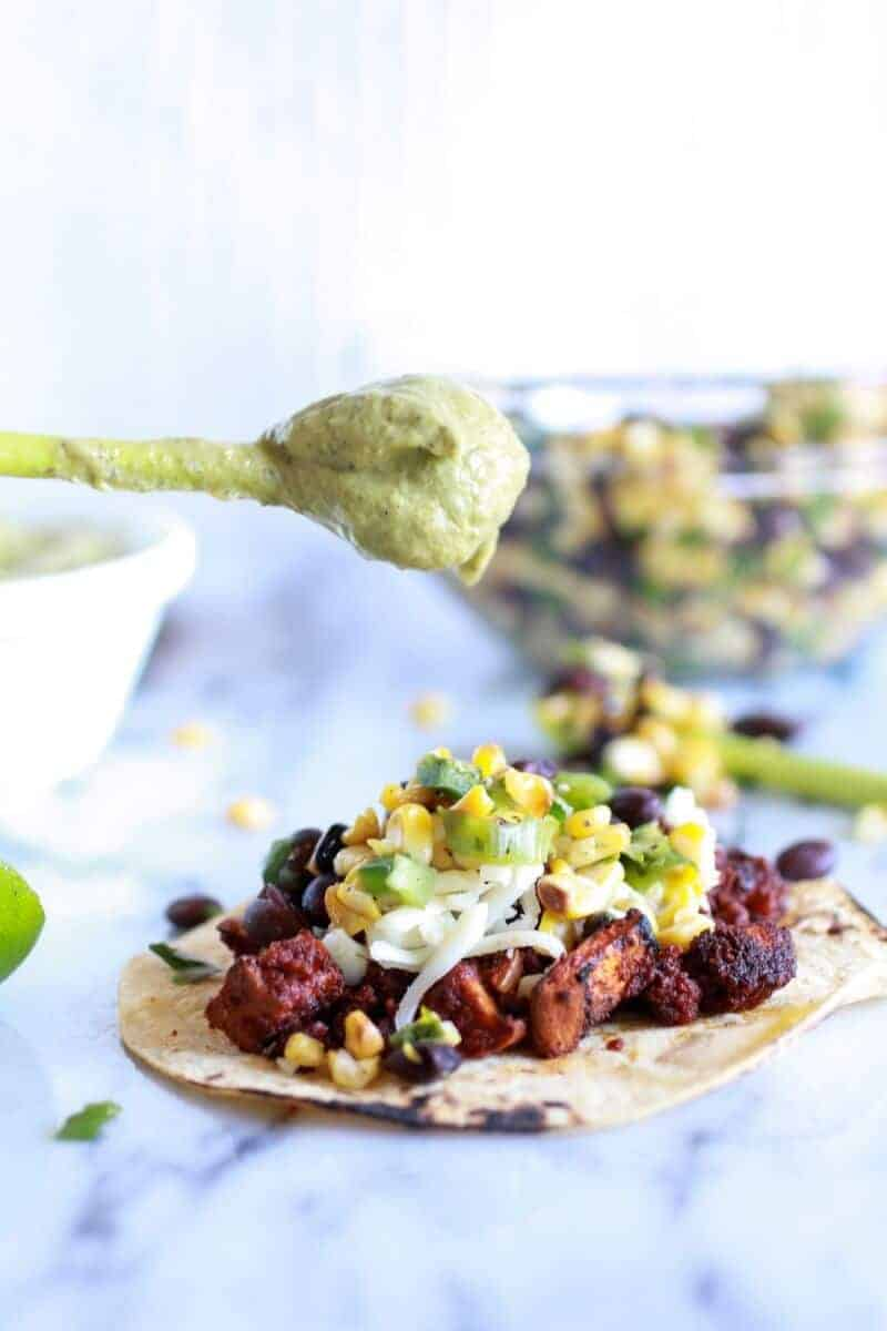 Sweet potato + Chorizo Tacos with Black Bean Salsa and Roasted Poblano Avocado Crema | halfbakedharvest.com