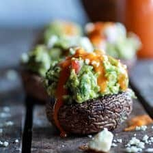 Blue Cheese Guacamole Stuffed Mushrooms with Buffalo Sauce