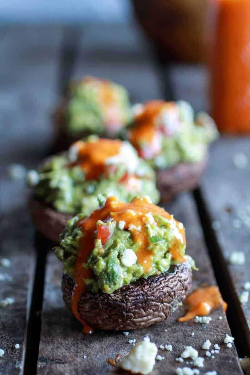 Blue Cheese Guacamole Stuffed Mushrooms with Buffalo Sauce | halfbakedharvest.com