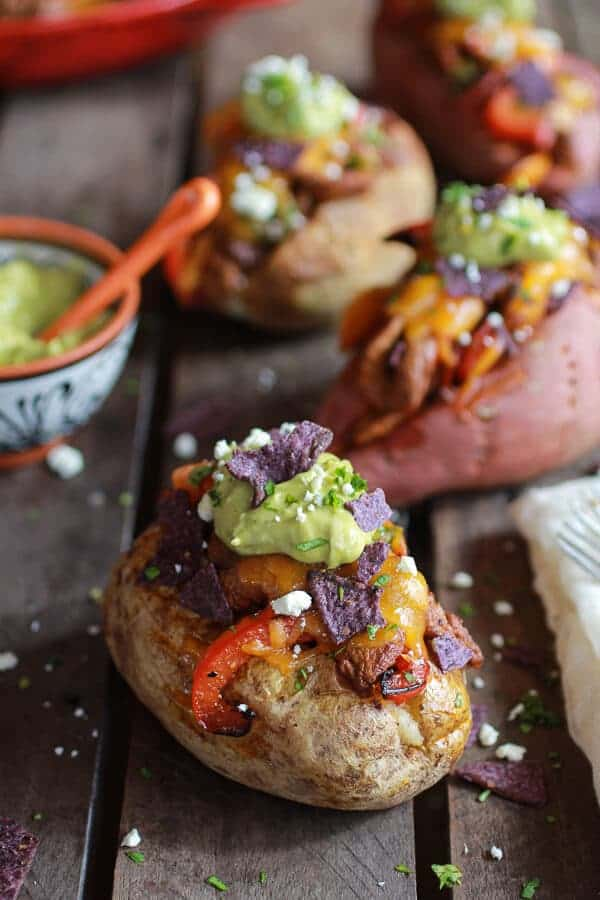 Steak Fajita Stuffed Baked Potatoes with Avocado Chipotle Crema | halfbakedharvest.com