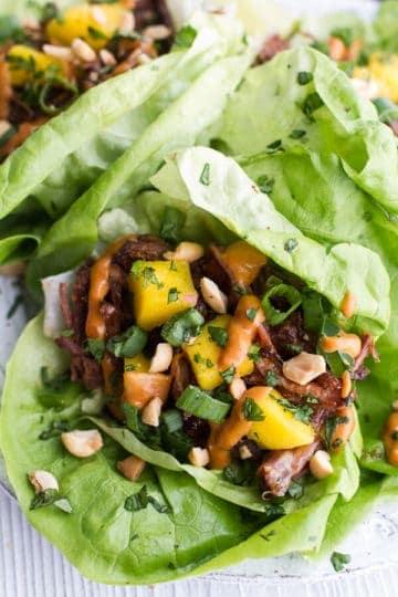 Crockpot Curried Thai Short Rib Lettuce Wraps with Peanut Sauce + Mango Salsa.