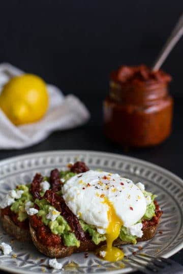 Harissa, Smashed Avocado + Egg Toast with Goat Cheese and Honey Drizzle.