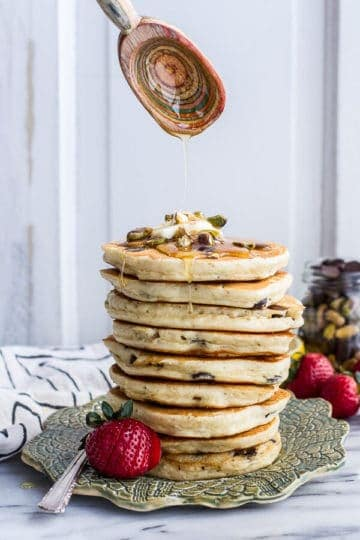 Chocolate Chip Lemon Baklava Pancakes with Salted Vanilla Honey Syrup.