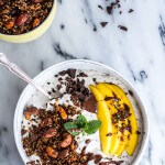 Coconut Banana Oats Bowl with Crunchy Black Sesame Quinoa Cereal + Mango.