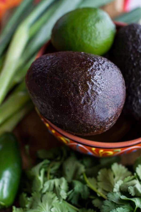 Cotija Guacamole + Chorizo Eggs Benedict with Honey Chipotle Lime Sauce | halfbakedharvest.com