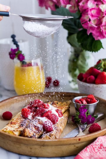 Lemon Ricotta Cheese Stuffed French Toast Crepes with Vanilla Stewed Strawberries.