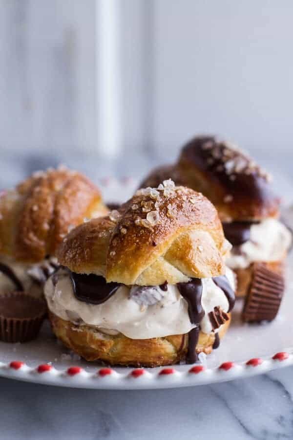 No-Churn Caramel Peanut Butter Cup Soft Pretzel Ice Cream Sammies w-Hot Fudge | halfbakedharvest.com