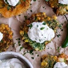 Spinach and Artichoke Corn Fritters with Brie and Sweet Honey Jalapeño Cream.