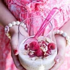 Vanilla Bean Coconut Quinoa Pudding with Honey Drizzled Raspberries.