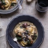 Taleggio Ravioli with Garlicy Butter Kale and Wild Mushroom Sauce + Toasted Pine Nuts.-1
