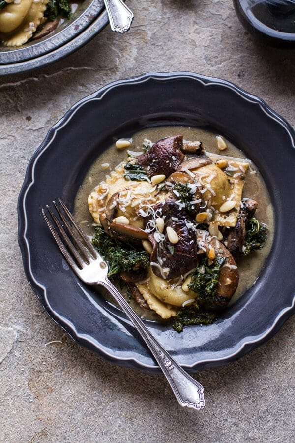 Taleggio Ravioli with Garlicy Butter Kale and Mushroom Sauce + Toasted Pine Nuts | halfbakedharvest.com @hbharvest
