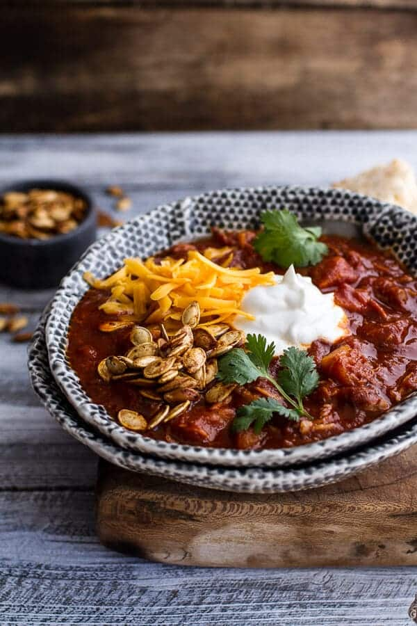 Crockpot Chipotle Pulled Pork Pumpkin Chili w/Cinnamon Roasted Pumpkin Seeds | halfbakedharvest.com @hbharvest