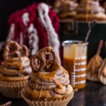 Death By Butterbeer Cupcakes w/Treacle Butter Frosting + Chocolate Covered Pretzels.