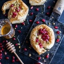 Goat Cheese Stuffed Phyllo Swirls with Pomegranate Honey + Pistachios.