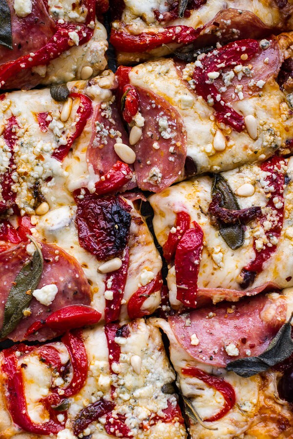 Pita Pizzas With Caramelized Onions, Sun-Dried Tomatoes, Olives And ...