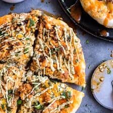 Buffalo Roasted Cauliflower Pizza with Chipotle Blue Cheese Avocado Drizzle.
