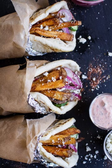 Greek Style Roasted Lamb Gyros with Harissa Spiced Tzatziki.
