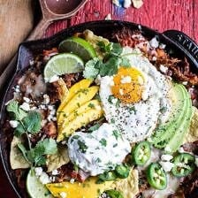 Carnitas Chilaquiles with Whipped Jalapeño Cream.