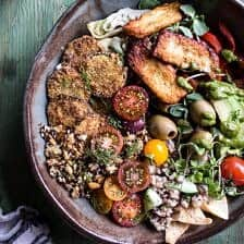 """Greek Goddess Grain Bowl with """"Fried"""" Zucchini, Toasted Seeds and Fried Halloumi."""