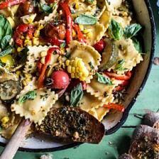 Garden Veggie and Ravioli Skillet with Pistachio Herb Butter.