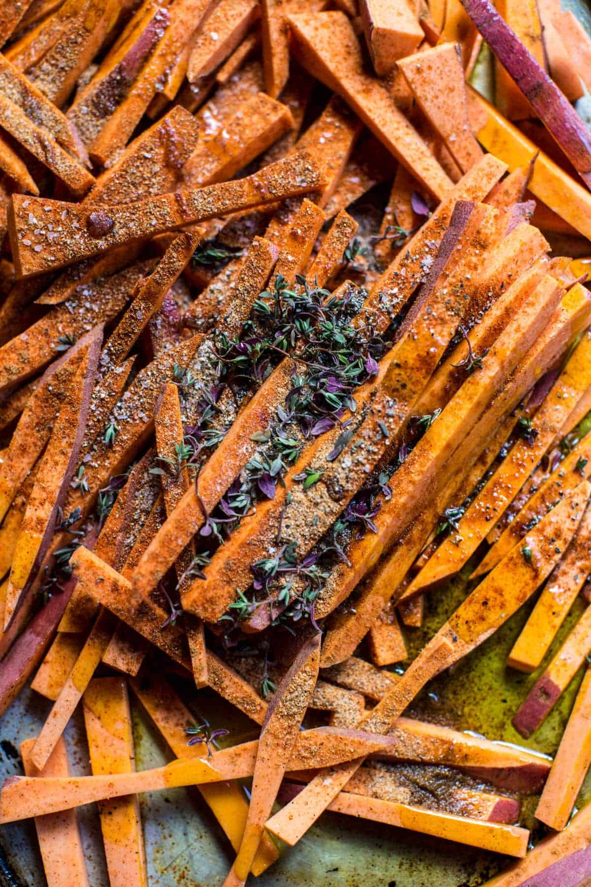 Skinny Cajun Sweet Potato Fries with Garlic Cheese Sauce | halfbakedharvest.com @hbharvest