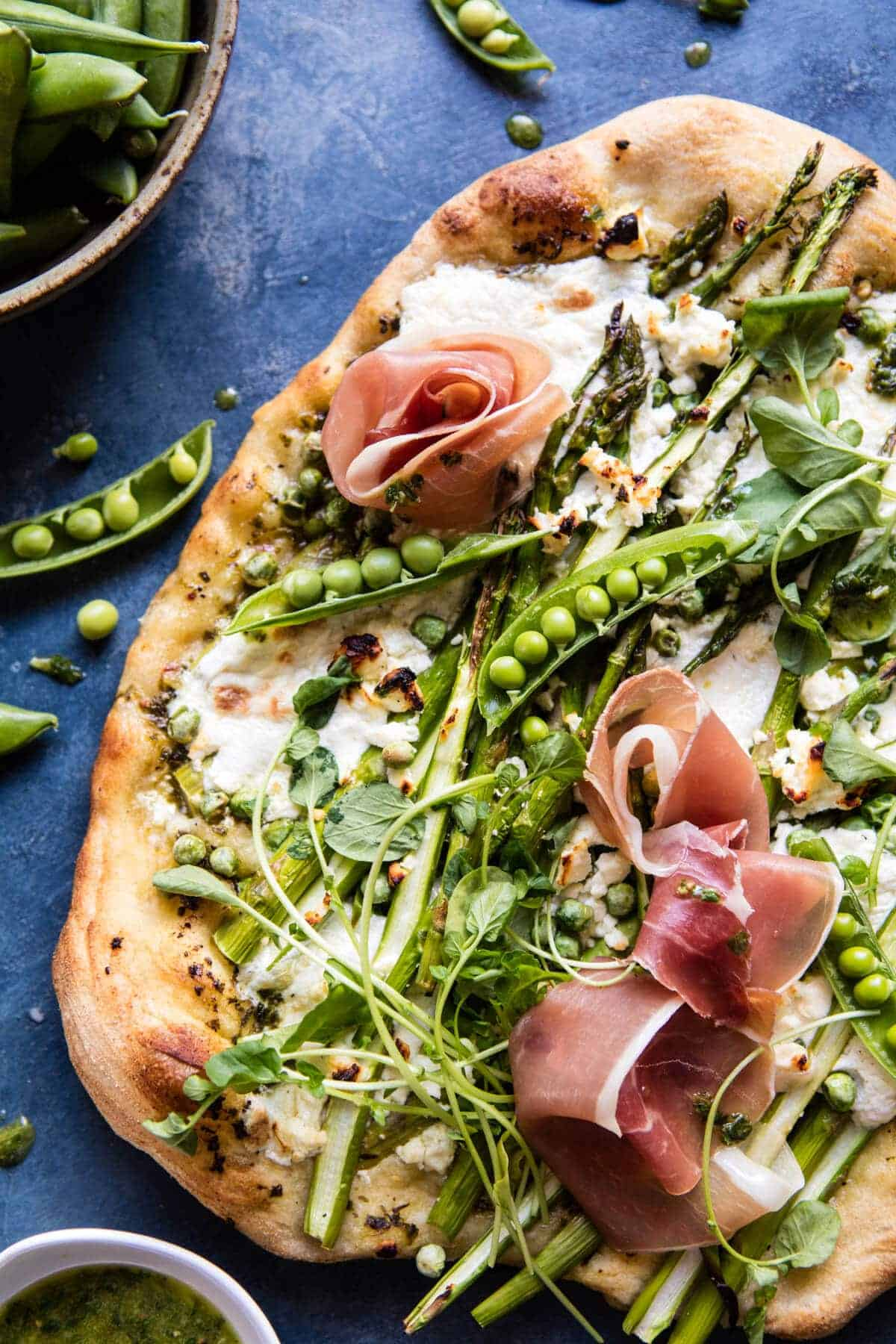 Super Green Pea and Asparagus Burrata Pizza | halfbakedharvest.com @hbharvest