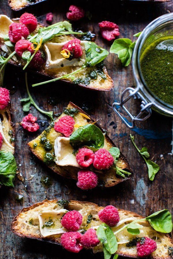 Honey Raspberry Brie Crostini with Basil Oil | halfbakedharvest.com @hbharvest