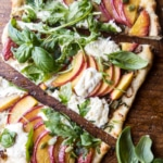 Arugula Peach Ricotta Pizza with Crispy Bacon.