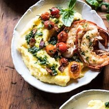 Brown Butter Lobster with Kale Pesto Polenta and Cherry Tomato Bacon Pan Sauce.
