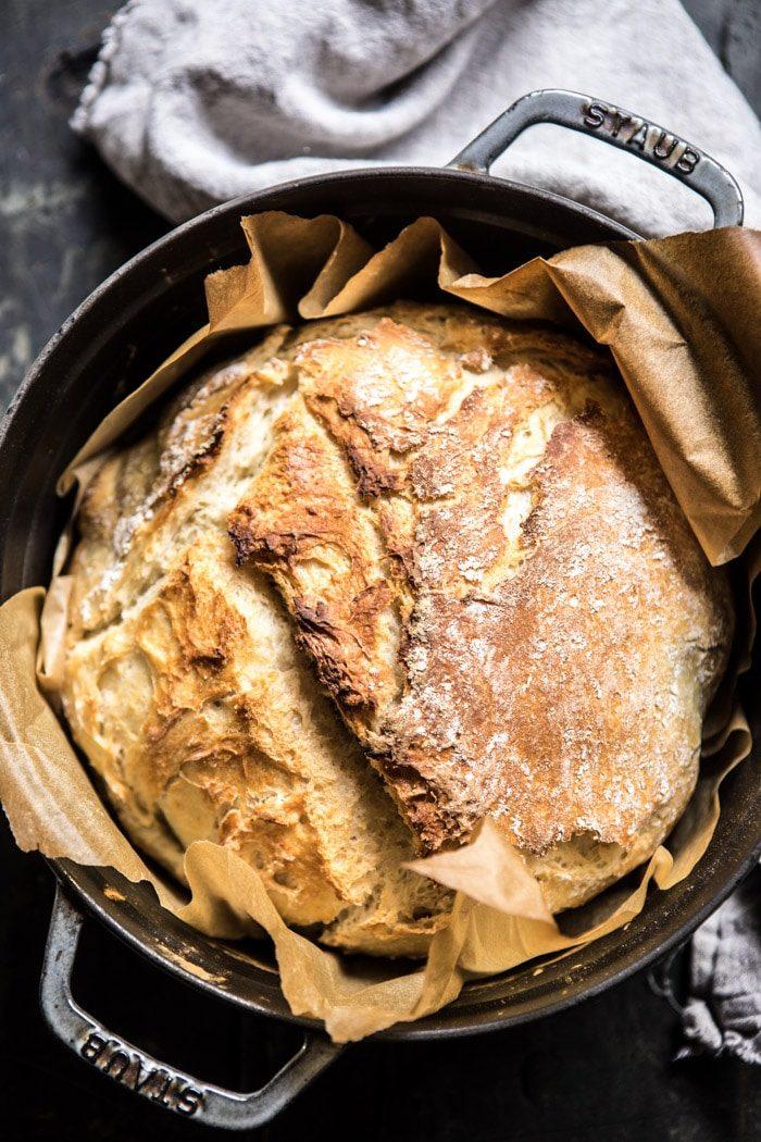 overhead photo of Cheaters No Knead Dutch Oven Sourdough Bread in dutch oven
