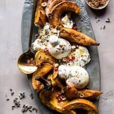 Honey Butter Roasted Acorn with Burrata and Pomegranate.