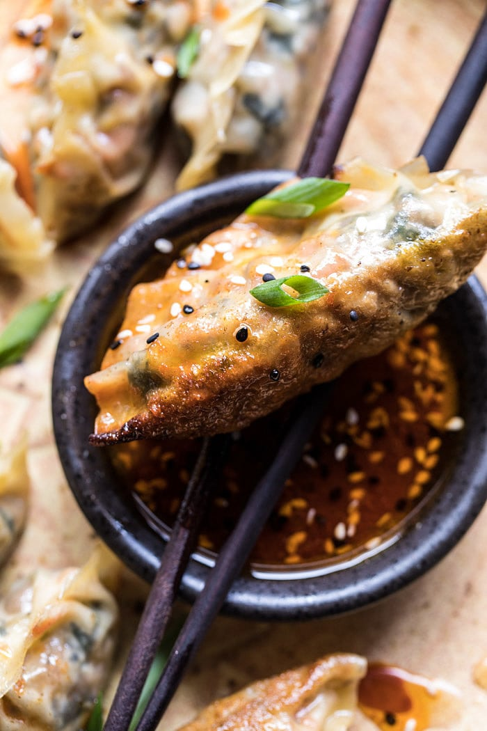 Homemade Vegetable Potstickers with Toasted Sesame Honey Soy Sauce | halfbakedharvest.com #vegan #recipes #healthy #homemade