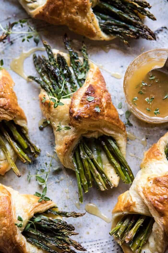 overhead close up photo of Asparagus and Brie Puff Pastry with Thyme Honey