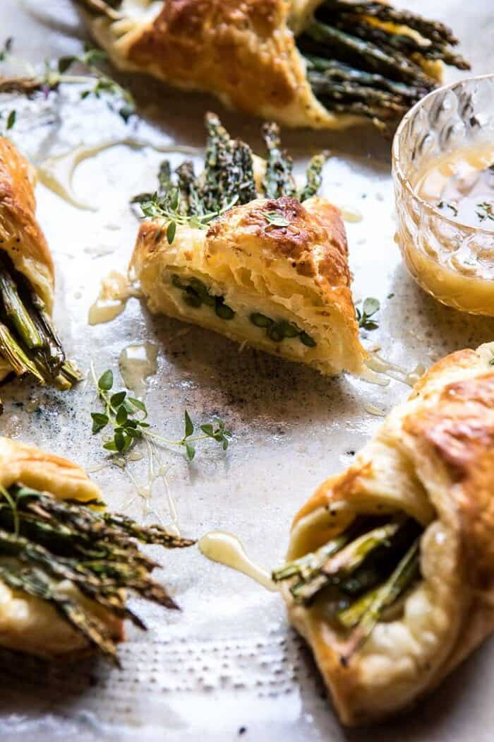 side photo of cut into Asparagus and Brie Puff Pastry with Thyme Honey