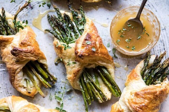 overhead horizontal photo of Asparagus and Brie Puff Pastry with Thyme Honey