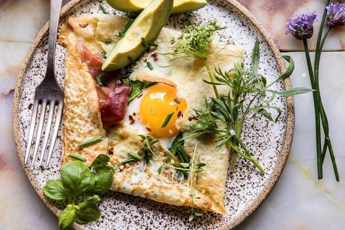 horizontal photo of Baked Egg Crepes with Spring Herbs and Avocado