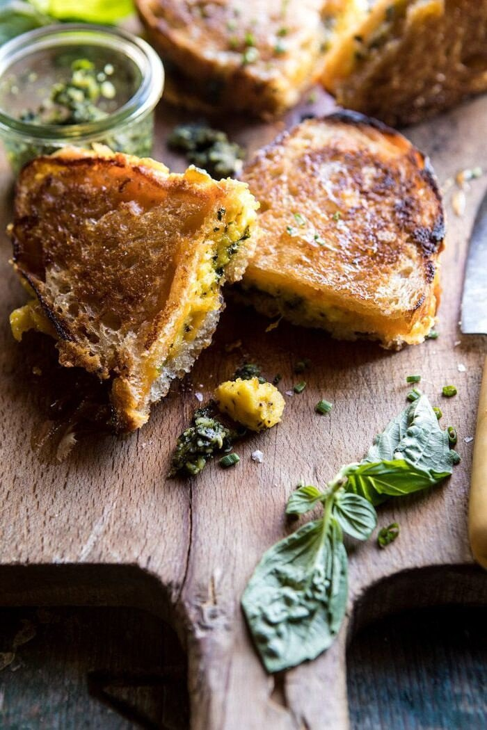 front on photo of Breakfast Grilled Cheese with Soft Scrambled Eggs and Pesto