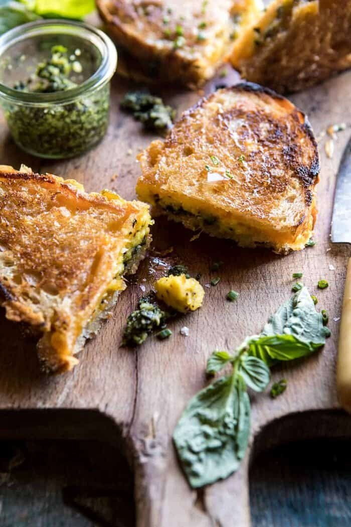 front on photo of Breakfast Grilled Cheese with Soft Scrambled Eggs and Pesto with basil