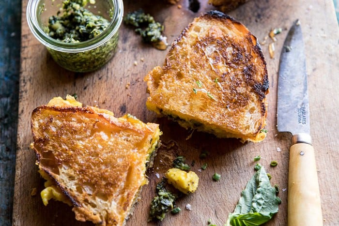 horizontal angled photo of Breakfast Grilled Cheese with Soft Scrambled Eggs and Pesto