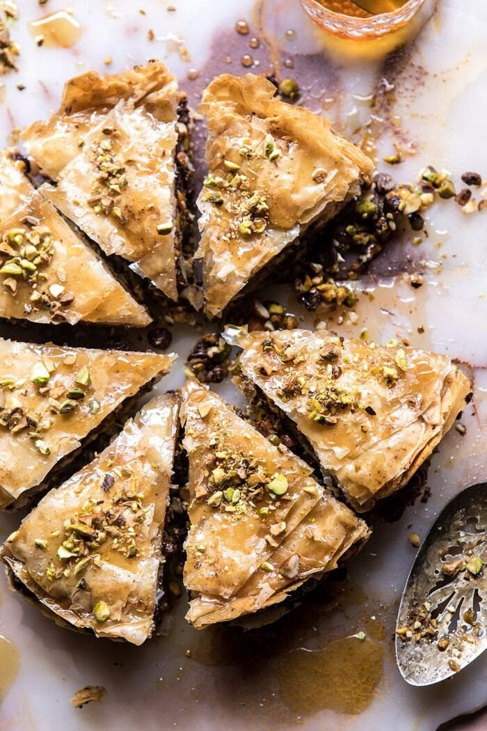 overhead photo of Easy Pistachio Chocolate Baklava with piece missing