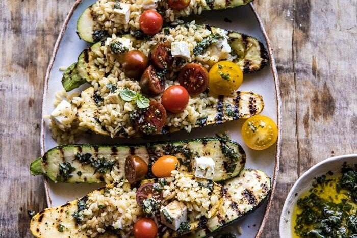 overhead horizontal photo Grilled Pesto Zucchini Stuffed with Tomatoes and Orzo