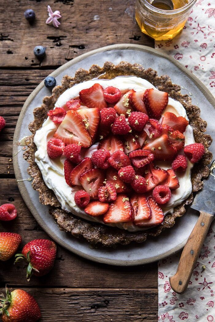 overhead photo of No Bake Greek Yogurt Fruit Tart with honey and spoon
